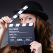 Woman with movie clapper board — Stock Photo #23150808