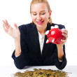 Royalty-Free Stock Photo: Woman breaking piggy bank for savings