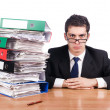 Young busy businessman at his desk — Stock Photo #23153306