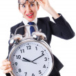 Stock Photo: Nerd businesswomwith gialarm clock