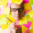 Businesswoman with lots of reminder notes — Stock Photo #23158408