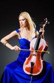 Attractive woman with cello in studio — Stock Photo
