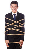 Businessman tied up with rope on white — Stock Photo