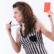 Womreferee with card on white — Stock Photo #23446000