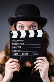 Woman with movie clapper board — Stockfoto