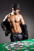 Naked broke businessman in casino — Stock Photo