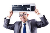 Nerd businessman with computer keyboard on white — Stock Photo