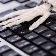Skeleton working on the keyboard — Stock Photo