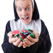 Nun in the gambling concept - Stock Photo