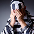 Royalty-Free Stock Photo: Convict criminal in striped uniform