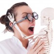 Doctor with skeleton on white — Stockfoto