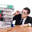 Young busy businessman at his desk - Stock Photo