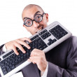 Nerd businessman with computer keyboard on white - Stockfoto