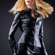 Attrative woman in leather suit — Stock Photo