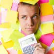 Businesswoman with lots of reminder notes — Stock Photo #23655249