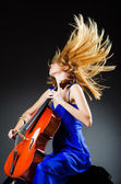 Attractive woman with cello in studio — Stock Photo