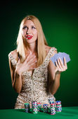 Woman in casino playing cards — Stock Photo