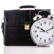 Alarm clock and briefcase isolated on white — Stock Photo #23869933