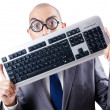 Nerd businessman with computer keyboard on white - Photo