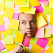 Royalty-Free Stock Photo: Businesswoman with lots of reminder notes