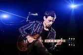 Man playing guitar during concert — Stock Photo