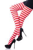 Mujer con las piernas largas y medias — Foto de Stock