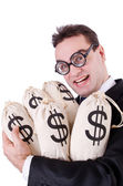 Businessman with sacks of money on white — Stock Photo