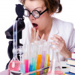 Crazy woman chemist in lab - Stock fotografie
