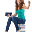 Student sitting on stack of books — Stock Photo #24064059