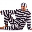 Stock Photo: Inmate in stiped uniform on white