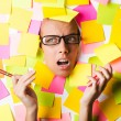 Businesswoman with lots of reminder notes — Stock Photo