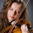 Attractive woman with cello in studio — Foto Stock