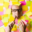 Stock Photo: Businesswoman with lots of reminder notes