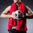 Stock Photo: Football player with ball and towel