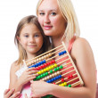 Mother and daughter with abacus on white — Stock Photo
