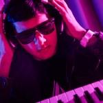 DJ mixing music at disco — Stock Photo