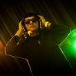 DJ mixing music at disco — Stock Photo #24309457