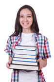 Student girl with many books on white — Foto Stock