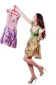 Mujer tratando de elegir el vestido de blanco — Foto de Stock