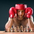 Royalty-Free Stock Photo: Boxer stuggling with chess game
