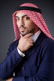 Arab businessman in dark studio — Stock Photo