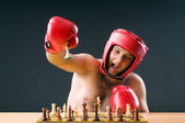 Boxer stuggling with chess game — Stock Photo