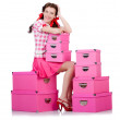 Young woman with storage boxes on white — Stock Photo
