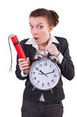 Businesswoman with dynamite and clock — Stock Photo