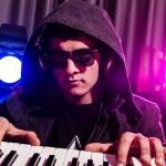 DJ mixing music at disco — Stock Photo #24534027