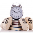 Sacks of money and alarm clock on white — Foto Stock