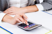 Hands working on the calculator — Stock Photo