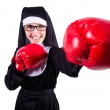 Nun with boxing gloves isolated on white — Stock Photo #24770399