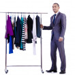 Businessman with rack of clothing — Stock Photo #24770849