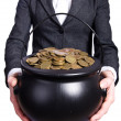 Stock Photo: Woman holding pot of gold coins